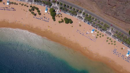 infrastruktura : Top view of Las Teresitas beach, road, cars in the parking lot, golden sand beach and the Atlantic Ocean. Tenerife, Canary Islands, Spain Dostupné videozáznamy