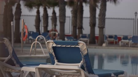 chaise longue : Pool with chaise-longues in hotel. 10.10.2017 Malaga, Spain