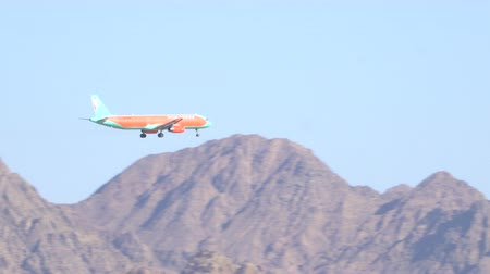 Airplane landing against a background of beautiful mountains. 17.03.2018 Sharm-El-Sheikh, Egypt