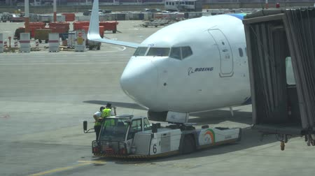 docking : Pushback tractor with Aircraft on the runway in airport, 15.04.2018 Tel-Aviv, Israel