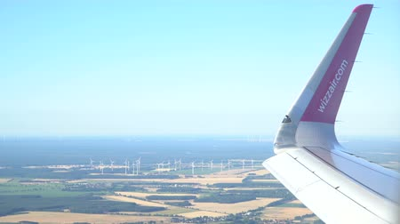 Airplane in flight over the Europe. Windmills in background. Magdeburg, Germany. 30.09.2018