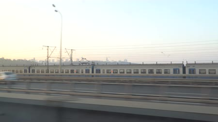 perspektif : Railway lines shines by sun rays, over Dnipro river. Kyiv Stok Video