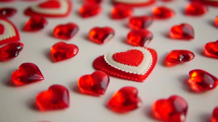 motion elements : Red hearts lay on a white background. How to get ahead.