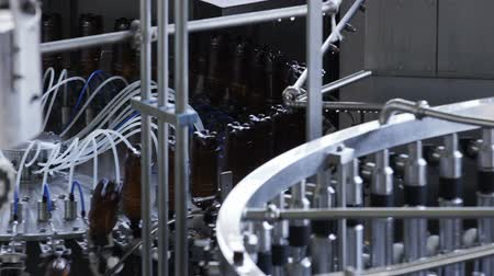 proces : Robotic Factory Line for Processing and Bottling of Beer and Juice into Plastic Bottles.