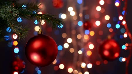 orange background : Christmas decorations on tree, branch, bokeh background, out of focus lights, Christmas and Happy New Year defocused abstract background. Very shallow deep of field.