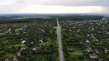 çatı : Aerial Drone Shot of a Village Suburban Sunny Day Crossroads Rainy Day