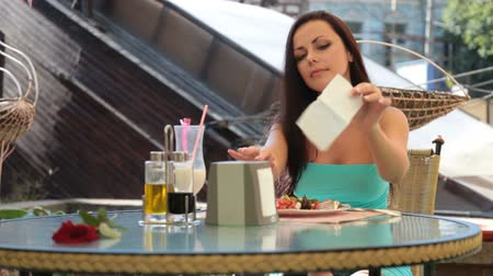 meal : woman dining in restaurant outdoors