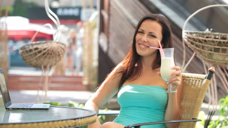 turmix : Beautiful Brunette drinking milk shake at Downtown Cafe Stock mozgókép