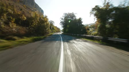 enrolamento : Driving on  winding mountain road Stock Footage