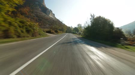 Driving on  winding mountain road Wideo