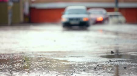 sel : car crossing a flooded road after strong rain