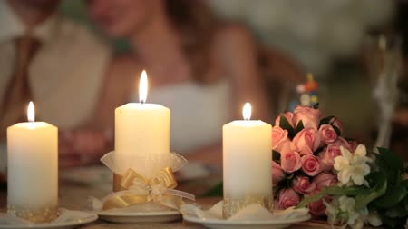 romantic couple : burning candles at the wedding table