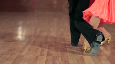 young dancers feet waltzing in ballroom