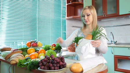 grocery : Pregnant woman with Groceries in kitchen