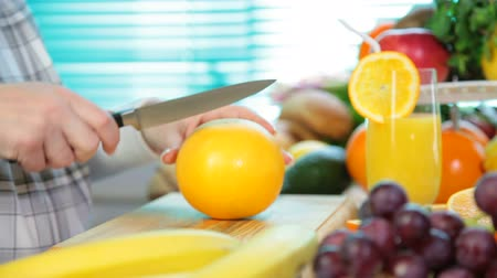 food preparation : Woman hands cutting grapefruit