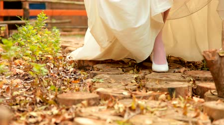 namoro : white wedding shoes in the autumn park Stock Footage