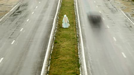 dehet : Pedestrian On Dividing Line Under The Rain