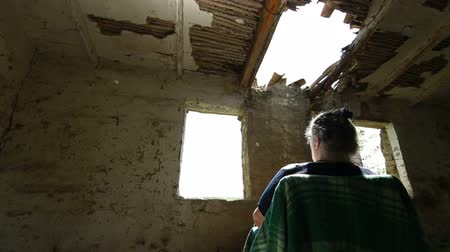 indigence : Mature Woman In An Abandoned Paternal House, Dolly Shot, Rear View Stock Footage