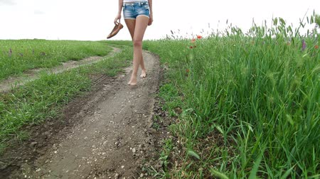 шорты : Barefoot Young Woman Walking A Country Road