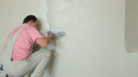 ceilão : Home Improvement - Plastering a Drywall Stock Footage