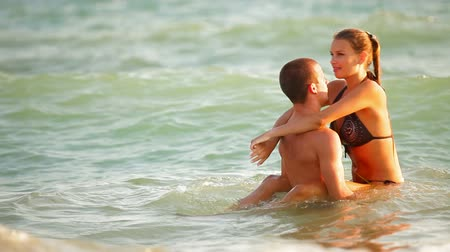 romantic couple : Young Couple Enjoying a Beach Vacation Stock Footage