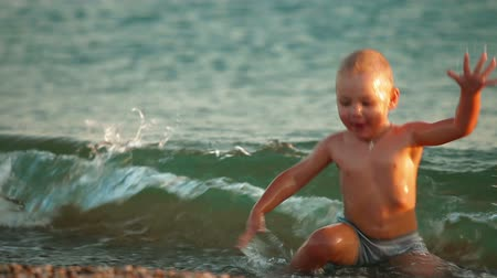 Happy Kid Splashing in the Surf