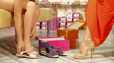 sapato : Mother and daughter trying on summer footwear in shoe store