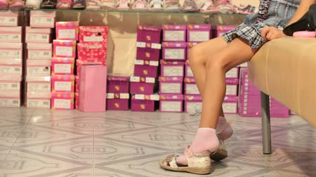 little : Choosing Shoes in Shoe Store Stock Footage