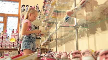 ayakkabı : Child Choosing Footwear in Shoe Store