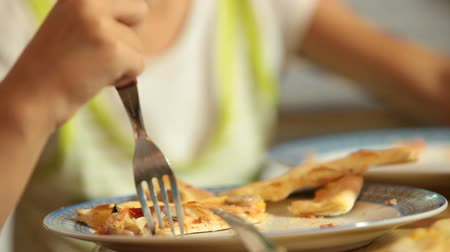 fome : Eating Pizza in Restaurant Closeup