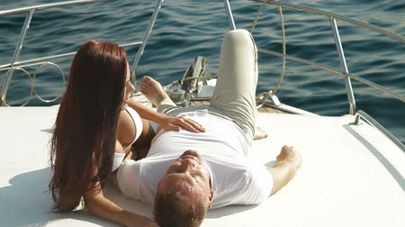yelkencilik : Couple relaxing on the yacht
