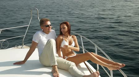 yelkencilik : Couple relaxing on the deck of luxury yacht Stok Video
