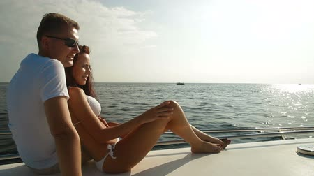 żaglówka : Couple Enjoying the Cruise on Luxury Yacht