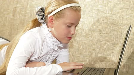 домашнее задание : Blonde little girl using laptop at home