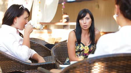 pletyka : Female Lively Conversation at Outdoor Cafe