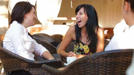 dialog : Female friends informal conversation in outdoor cafe