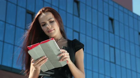 android : Young Woman with Digital Tablet in Downtown