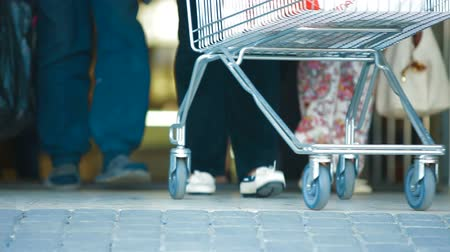 entrance : People with Shopping Cart Walking Through the Doors of Supermarket Stock Footage