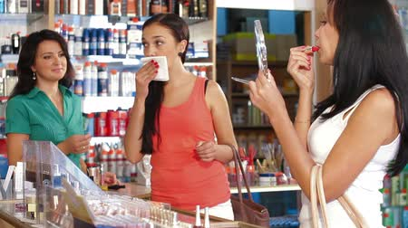 ruj : Female Customers in Cosmetics Store