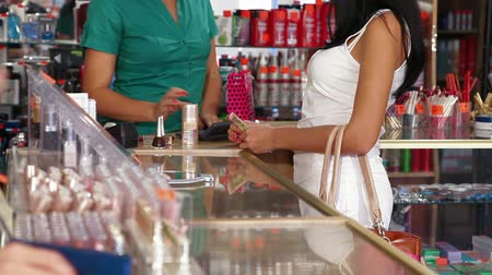 counter : Woman paying for beauty care products at the cash counter