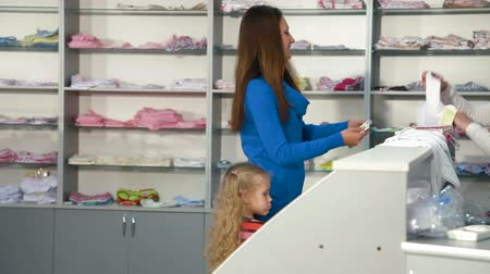calcinhas : Mother and little daughter shopping for girls clothes in a clothing store, looking kids underwear