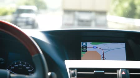 gösterge paneli : Man Driving Car With Integrated GPS Navigation