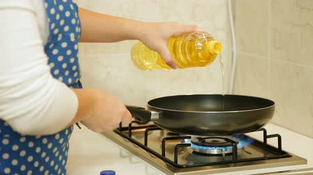 pans : Food Preparation - Pouring Oil Into Frying Pan Stock Footage