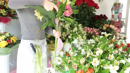 alstroemeria : Florist Arranging Bunch Of Flowers In Floristry Shop