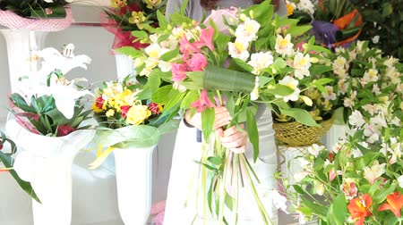 flower shops : Florist Making Alstroemeria Bouquet In Flower Shop Stock Footage
