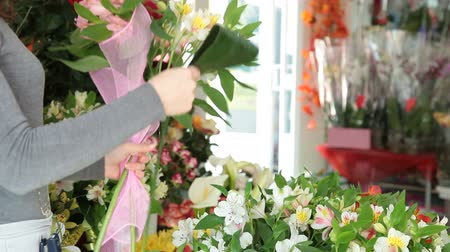alstroemeria : Florist Arranging Bunch Of Flowers In Her Store Stock Footage