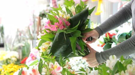flower shops : Florist Arranging Bouquet Of Alstroemeria
