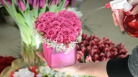 floral composition : Pink Valentines Day Rose Heart Bouquet In Flower Shop Stock Footage