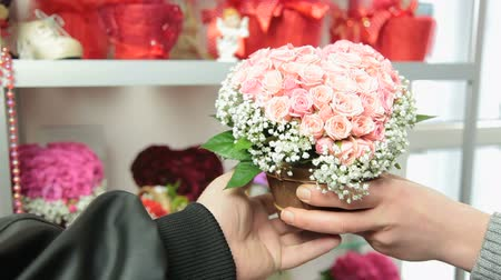 flower shops : Florist Serving Customer in Flower Shop Stock Footage
