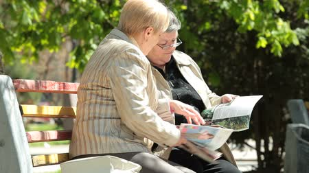 positive ageing : Senior Women Reading Magazines In The Park